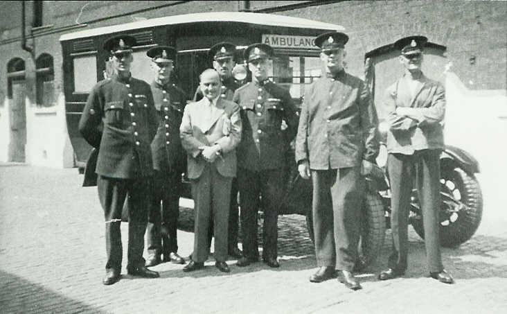 Police Austin ambulance at Central Fire Station, Park Road, Portsmouth (now King Henry I Street) PC Syd Boyland is far left.